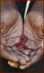 HIV symbol in hands (Aids).