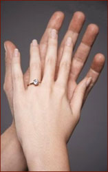 Left-handed male hand & female hand.