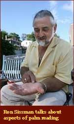 Palm reader Ron Sissman looks for signs of client's inner life.