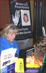 Palm reader Myrna Lou Goldbaum hosts a palm reading event.