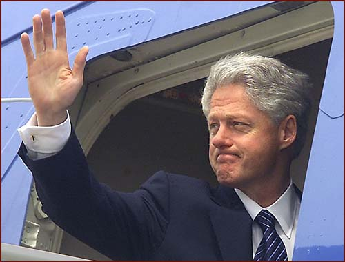 Former US president Bill Clinton: right hand waving.