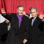 Former US president George H.W. Bush and his son George W. Bush: waving hands.