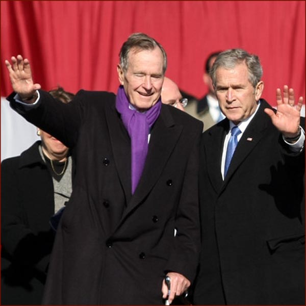 US president George H.W. Bush & George W. Bush waving hands