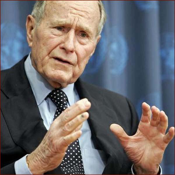 US president George H.W. Bush: hand gesture photo