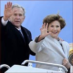 Former US president George W. Bush & his wife Laura Bush: waving hands.