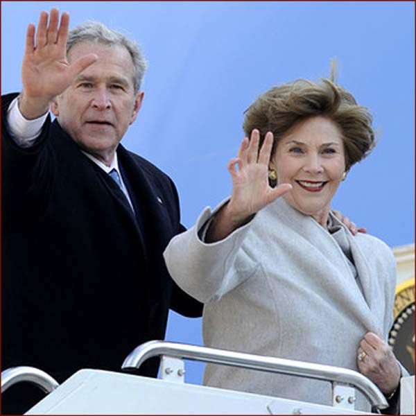 Former US president George W Bush: hand waving with Laura Bush photo.