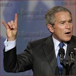 Former US president George W. Bush: hook 'em horns hand gesture.