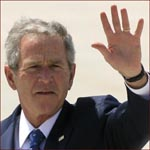 Former US president George W. Bush: left hand wave.