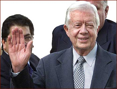 Former US president Jimmy Carter: hand waving photo of his right hand