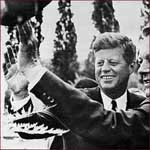 Former US president John F. Kennedy: right hand wave.