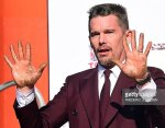Ethan Hawke has a complete simian line in his left hand.