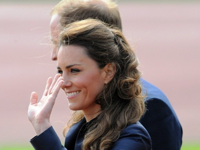 Kate Middleton's waving left hand.