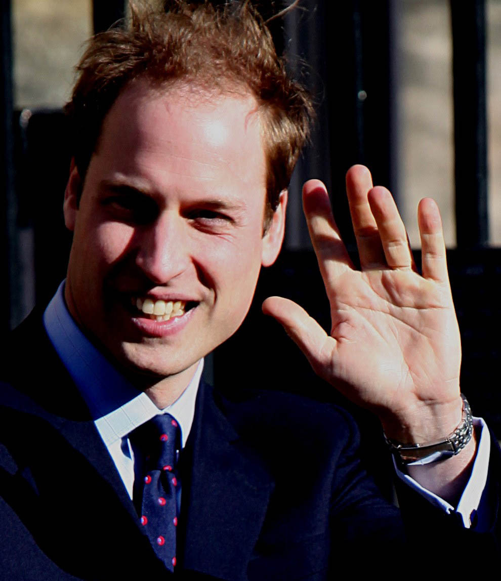 Prince William's waving left hand.