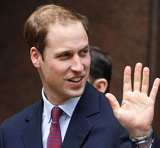 Prince William's left hand.