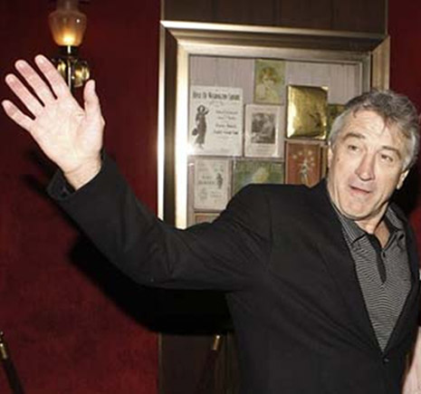 Robert de Niro's left hand is featured with a strong distal thumb phalange (strong impulse to 'will').