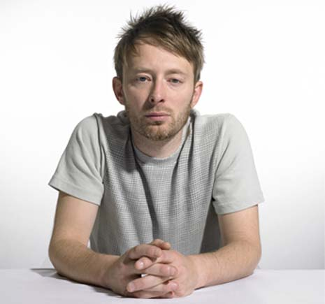 Thom Yorke with his thumbs folded.