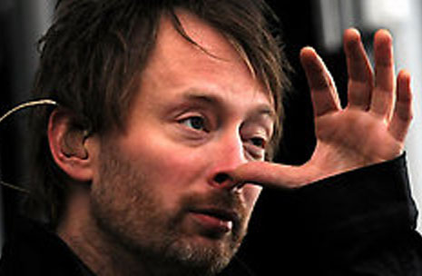 Thom Yorke's left hand is featured with a short heart line! ('broken' heart line)
