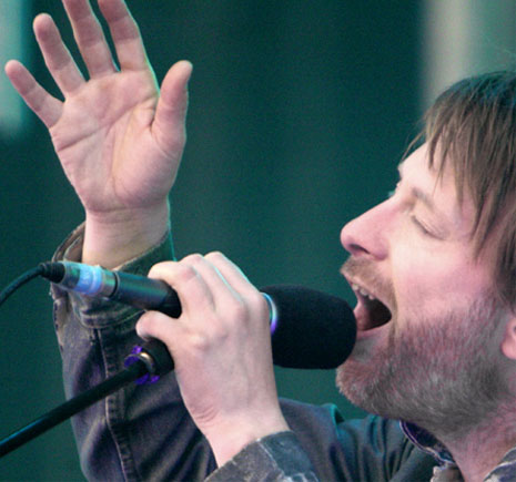 Thom Yorke has a simian line in his right hand.